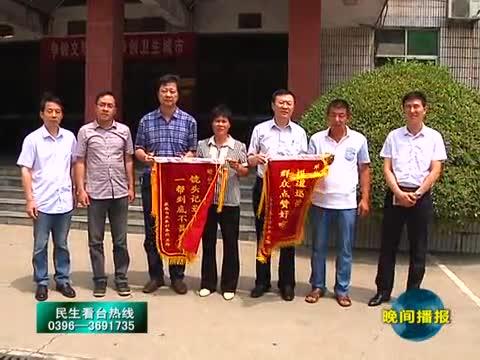 记者报道有力 瓜农送锦旗致谢