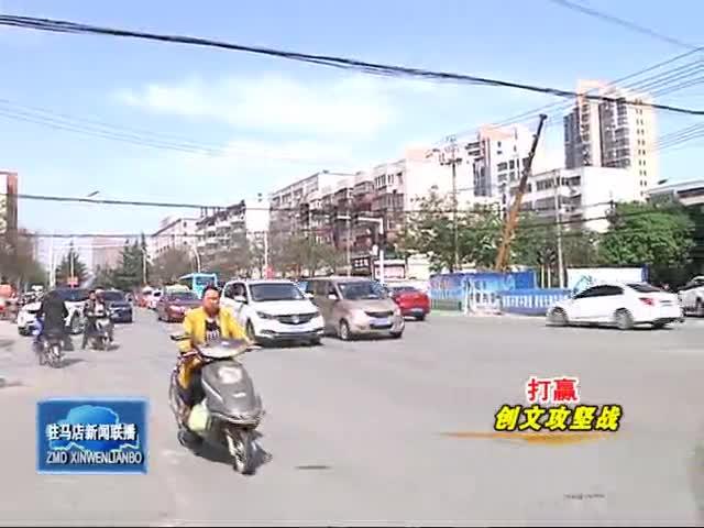 市区部分路段仍存在行人闯红灯 乱穿马路等现象