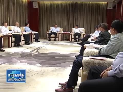 朱是西会见中国人寿保险河南省分公司总经理王新生一行